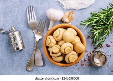 champignons marinated,pickled mushrooms with spice in bowl