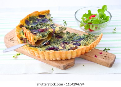Champignons, spinach and red onion quiche.