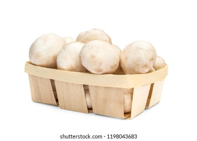 Champignons in wooden box on white background.