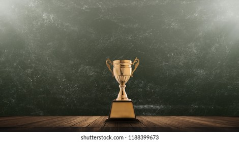 champion golden trophy placed on wooden table with blackboard background copy space ready for your design win concept.