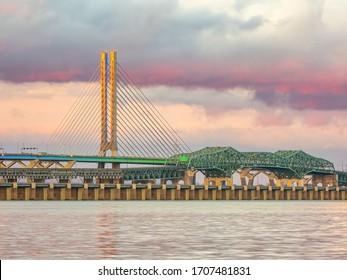 Champlain bridge, Samuel-De Champlain bridge and Estacade bridge aligned next to each others in Montreal, Quebec, Canada over the Saint Lawrence river.