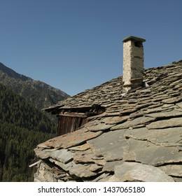 Champoluc, Aosta Valley, Italy - August 10, 2006: Traditional flagstone roof and chimney stack in the village of Vieux Crest.