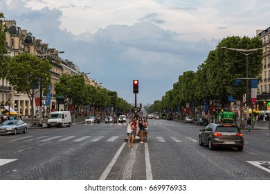 CHAMPS ELYSEES, PARIS, FRANCE – JULY 27, 2014: Fans and tourists on Champs Elysees main parisian street after the final of the bicycle race Tour de France in 2014.