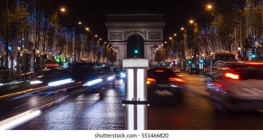 Champs Elysees in Paris illuminated for Christmas and Triumphal Arch in background