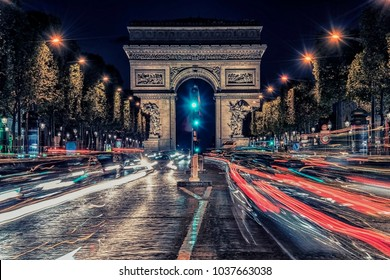 Champs-Elysees by night near the  Arc de Triomphe