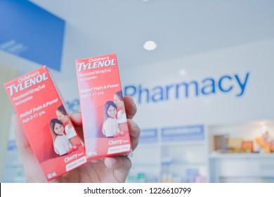 ๊Warin Chamrap,Ubon Ratchathani/Thailand-11-11-2018 :  A hand holding Tylenol syrup pack. Tylenol is a band of drug for reduce pain and fever. Produced by OLIC(Thailand).