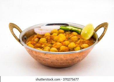 Chana Masala - An Indian spicy vegetarian dish for lunch and dinner