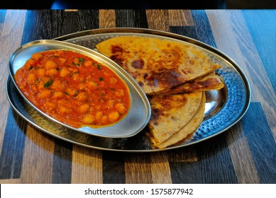 Chana Masala with Paratha, made of chickpeas and selected Indian spices and served with flat bread