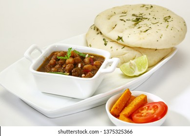 Chana Masala or Spicy Chick Peas with with Kulcha, Indian Food
