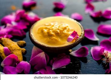 Chana,haldi,limbo & milk  ka ubtan or ayurvedic face pack of Turmeric, Lemon,gram flour & milk on wooden surface for good skin and no black heads or any skin related problems.