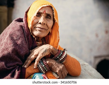 CHAND BAORI, INDIA - JANUARY 9, 2015: Portrait of senior Indian woman in traditional clothes on January 9, 2015 in Chand Baori, India