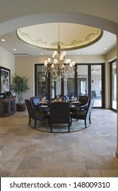 Chandelier above circular dining table