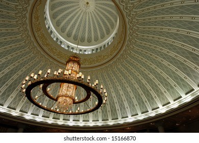 Chandelier and decorated ceiling in a mosque