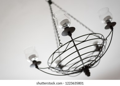 chandelier detail on candles, illuminated by bright colors of white interior, minimalist expression to the touch of history, candles and tea candles, variable solutions of modern interiors