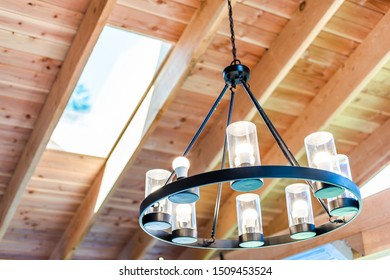 Chandelier handing from wooden ceiling with skylight hdr