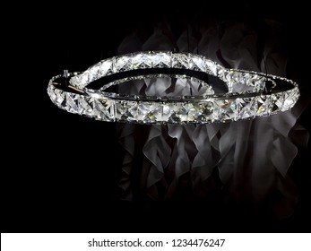 Chandelier, lamp, rings in the form of a decorative ornament made of precious stones, diamonds.