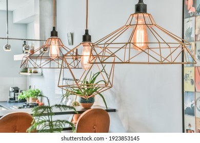 Chandelier with LED lamps in a modern house. Interior design of a new apartment