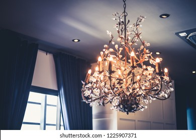 Chandelier light on wall in home, luxury interior decor