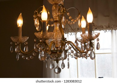 chandelier with lit candles