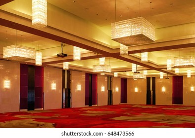 Chandelier with Red carpet in the room.