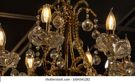 Chandelier.Home, beautiful chandelier.A luxurious lamp hangs from the ceiling.Brass chandelier with crystal.Chandelier ceiling lights, background with copy space.Closeup.