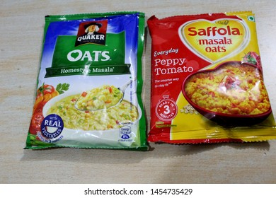 """""""Chandigarh , Punjab / India - July Thursday 2019: a view of quaker oats and saffola masala oats, packet view"""""""