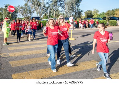 Chandler, AZ / USA April 11, 2018: Teachers, students, and parents advocating for increase funding for K-12 education, as other parents drop of their children for school at Brisas Elementary School.
