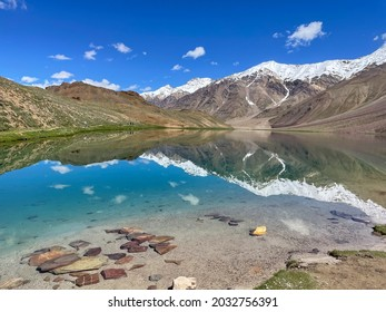 """Chandra Tal lake in Spiti valley, Himachal Pradesh, India. Chandra Tal lake  also known as Lake Of The Moon. The name """"Chandra Taal"""" (Lake of the Moon) comes from its crescent shape."""