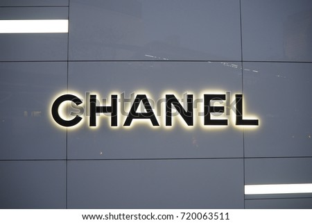 6b754de0f510 Chanel logo in front of Chanel boutique store at Emquartier department  store Bangkok Thailand at night