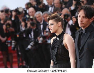 Chang Chen and Kristen Stewart attend  the opening gala during the 71st annual Cannes Film Festival at Palais des Festivals on May 8, 2018 in Cannes, France.