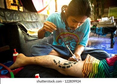 CHANG, THAILAND - DEC 24: Unidentified master makes traditional tattoo bamboo, Dec 24, 2012 in Chang, Thailand. Thai tattooists are very popular among tourists, prices range from 500 thai baht and up.