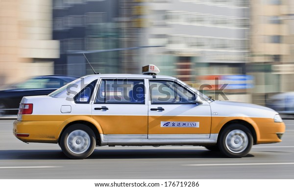 CHANGCHUN, CHINA - JAN. 31, 2014. Taxi on the road. There are 12,000 taxis in Changchun, all metered. Generally most taxis charge a base fee of Y5 for 2.5 kilometers, with Y1 for each additional kilometer.