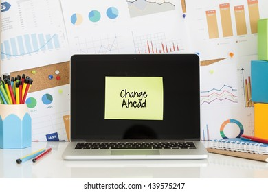 CHANGE AHEAD sticky note pasted on the laptop screen