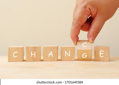 Change and chance on wooden cube concept. Hand pick G or C in change and chance on wooden cube.