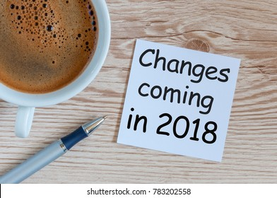 change is coming in 2018. text in message at workplace with morning coffee cup