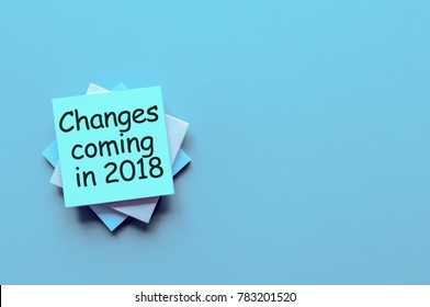 change is coming in 2018. text write on pile of paper