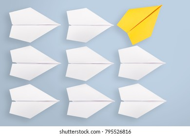 Change concept with blue paper airplane