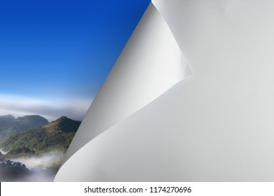 Change concept, turning blank paper page to revealing nature landscape, changing reality, hope inspiration,environmental protection, change weather, environmental campaign.