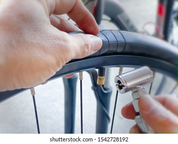 Change the inner tube and inflate the bike's wheel vehicle backgrounds