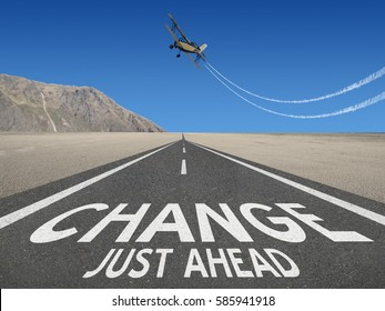 Change Just Ahead motivational text on highway to success