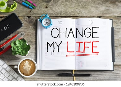 Change my life, personal goal or resolution for the new year handwritten on agenda