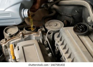 Change the Oil , close up selective focus, car engine oil change, engine maintenance