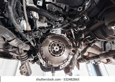 Change and repair clutch, drive axle. working underneath a lifted car