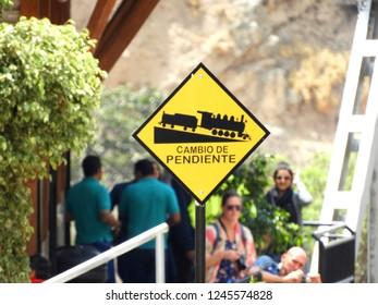 Change of slope, sign on the Devil's Nose train track in Ecuador