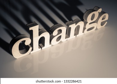 Change word by wood letters against the light to left the dark shadow behind the word