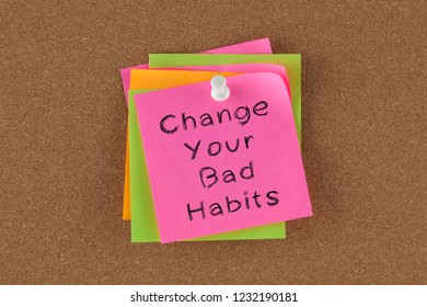 Change Your Bad Habits written on colorful note pinned on cork board.
