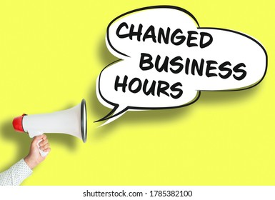 CHANGED BUSINESS HOURS poster or sign with megaphone and speech bubble against yellow background