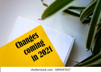 Changes coming in 2021, Text on notebook at white desk.