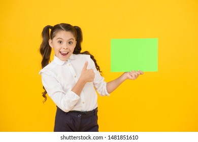 Changes coming. Upcoming event. Look here. Girl school uniform hold poster. Back to school concept. Schoolgirl pupil show poster. Schoolgirl hold poster copy space. News information promotion.