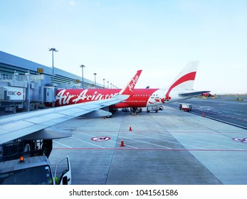 Changi Airport, Singapore. 6th March 2017:  Aircraft of the Air Asia Airline waiting for passengers, Air Asia company is the largest low cost airlines in Asia.